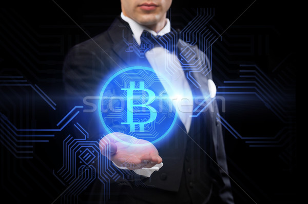 close up of magician with bitcoin symbol Stock photo © dolgachov