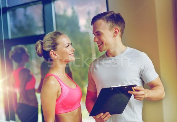 улыбаясь Личный тренер спортзал фитнес спорт Сток-фото © dolgachov