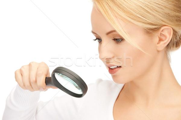 Сток-фото: женщину · увеличительное · стекло · фотография · красивая · женщина · лице · счастливым