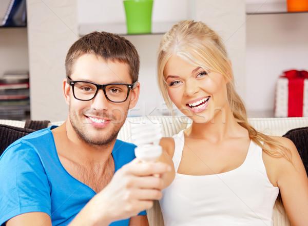 couple holding energy saving bulb  Stock photo © dolgachov