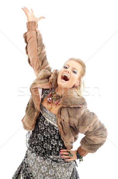 Chanter dame image fourrures veste blanche Photo stock © dolgachov