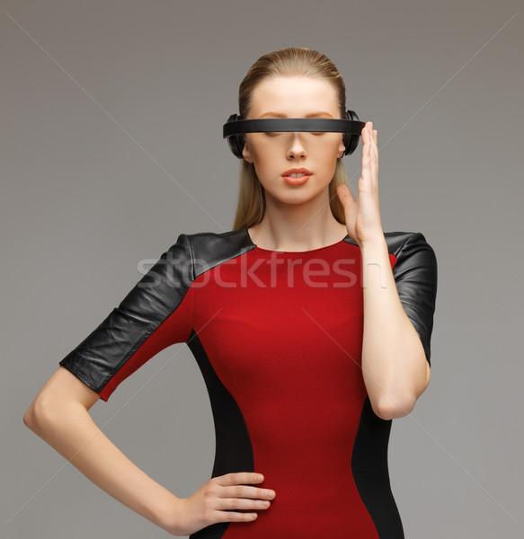 woman with futuristic glasses Stock photo © dolgachov
