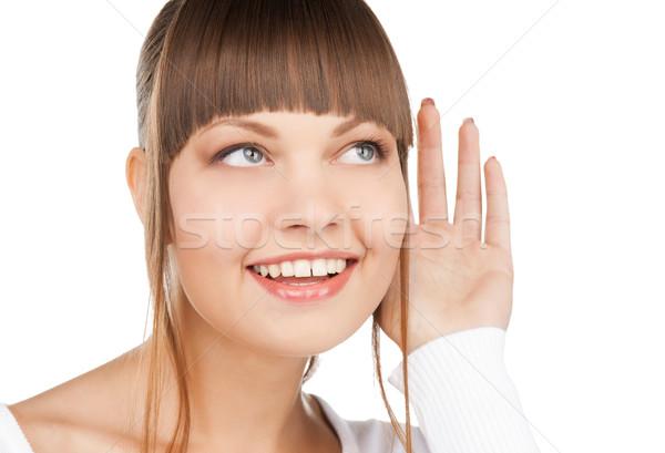 happy woman listening gossip Stock photo © dolgachov