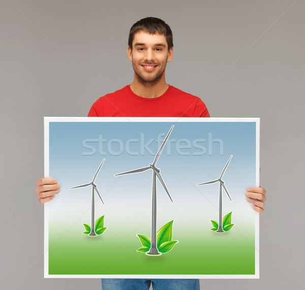 man with picture of wind turbines Stock photo © dolgachov