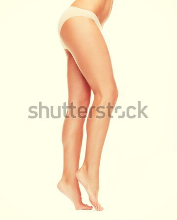 female legs in black bikini panties Stock photo © dolgachov