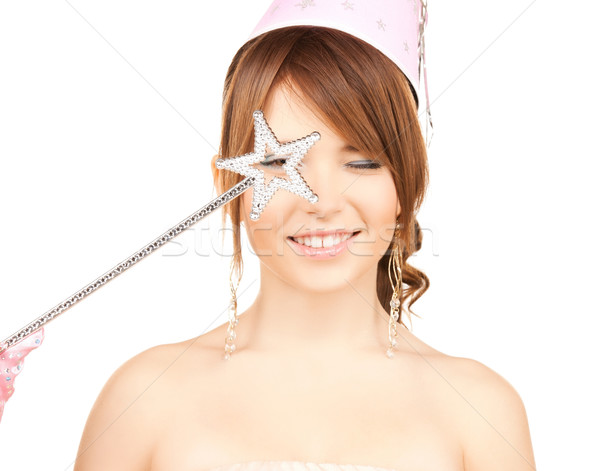 girl in party cap with magic stick Stock photo © dolgachov