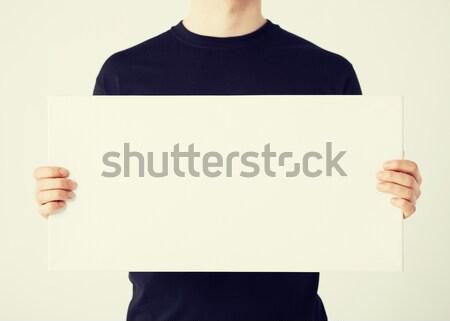 Férfi fehér tábla közelkép kezek mutat fehér Stock fotó © dolgachov