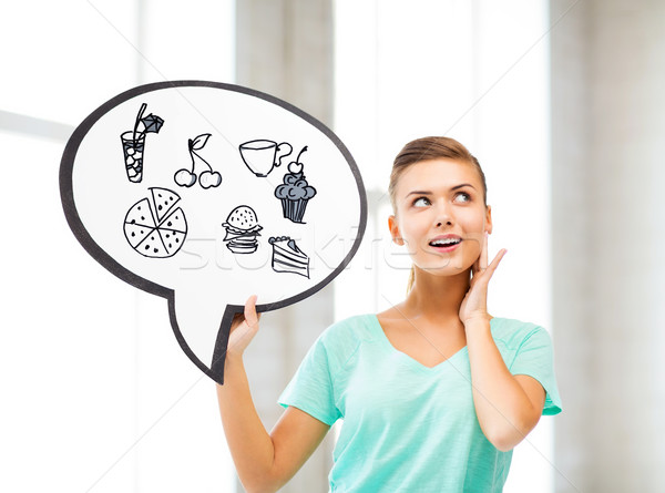 girl showing text bubble with junk food icons Stock photo © dolgachov