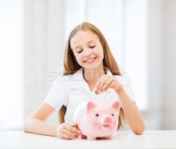 child with piggy bank Stock photo © dolgachov