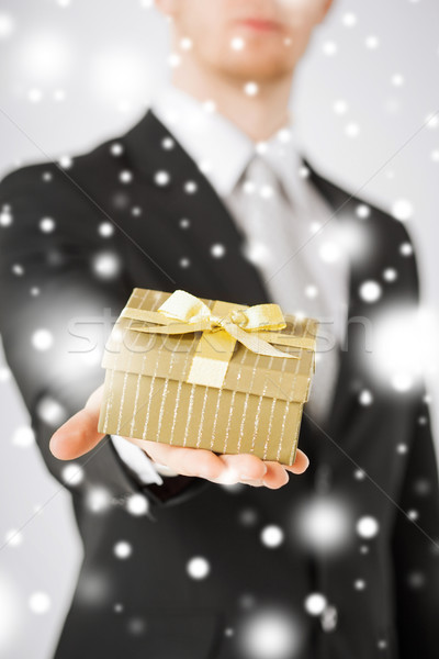 man giving gift box Stock photo © dolgachov