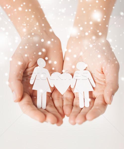 Mulher mãos papel mulheres homossexual direitos humanos Foto stock © dolgachov