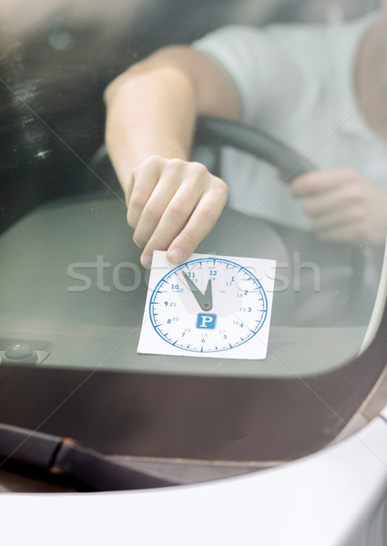 Homme parking horloge voiture tableau de bord transport Photo stock © dolgachov