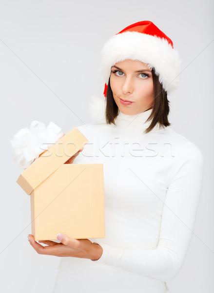 suspicious woman in santa helper hat with gift box Stock photo © dolgachov