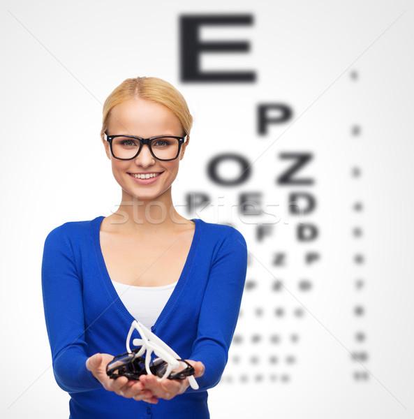 Сток-фото: улыбающаяся · женщина · очки · видение · здоровья