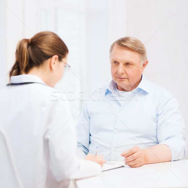 female doctor or nurse with old man prescrbing Stock photo © dolgachov