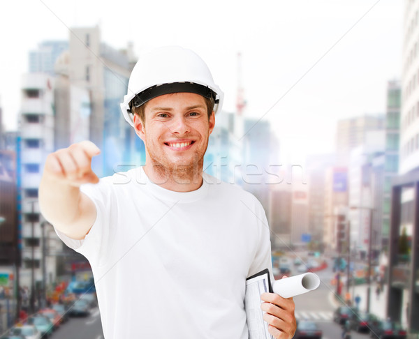 male architect in helmet pointing at you Stock photo © dolgachov