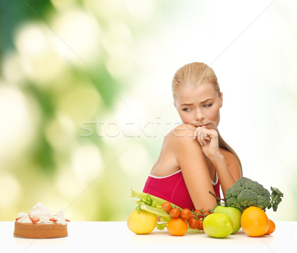 doubting woman with fruits and pie Stock photo © dolgachov
