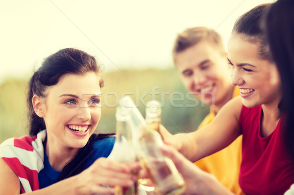 women and men with drinks on the beach Stock photo © dolgachov