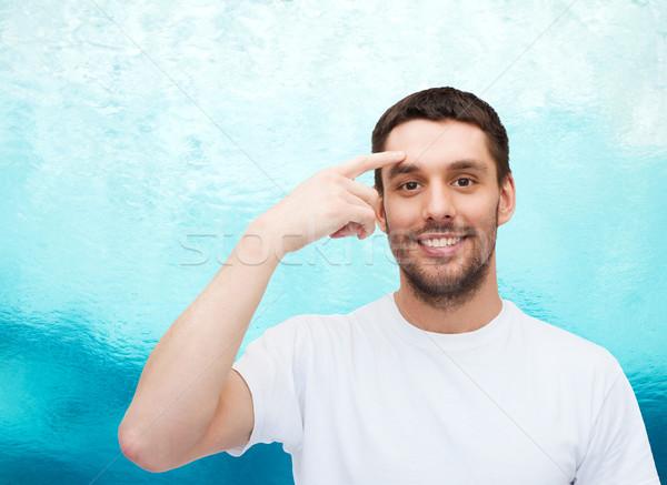 Mosolyog fiatal jóképű férfi mutat homlok egészség Stock fotó © dolgachov