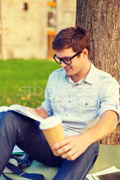 Adolescente leitura livro longe café Foto stock © dolgachov