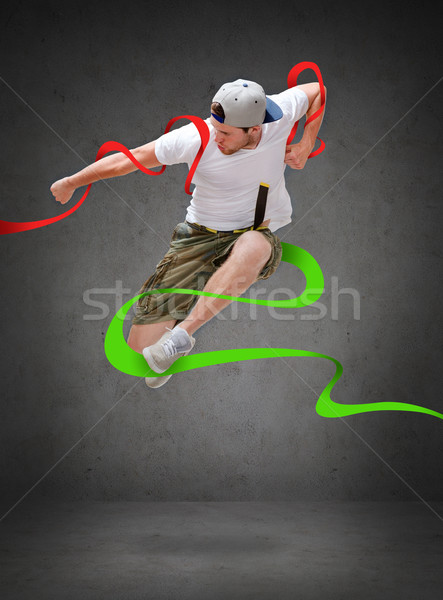 male dancer jumping in the air Stock photo © dolgachov