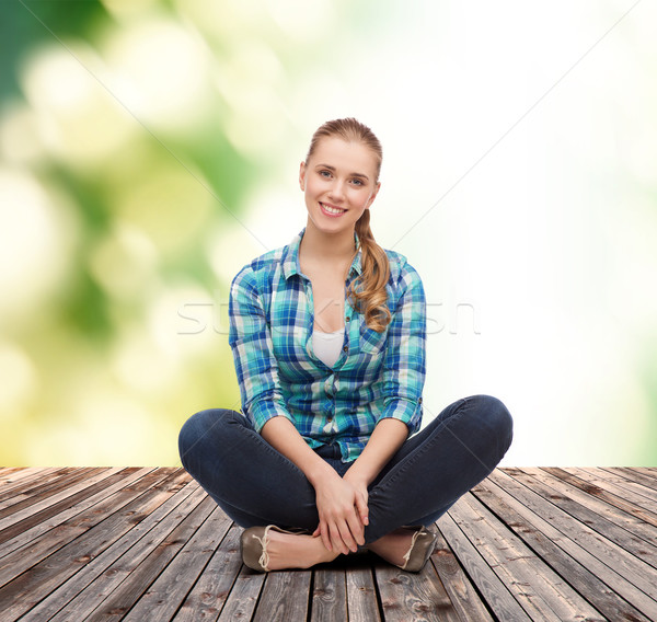 young woman in casual clothes sitting on floor Stock photo © dolgachov