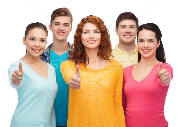 Grupo sonriendo adolescentes amistad Foto stock © dolgachov