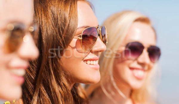 close up of smiling young women in sunglasses Stock photo © dolgachov