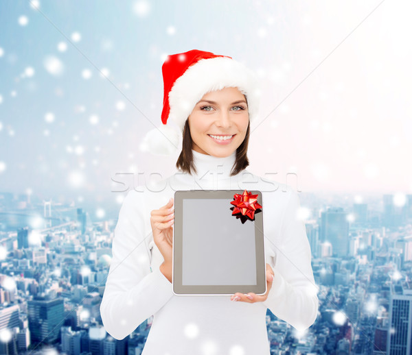 woman in santa helper hat with tablet pc Stock photo © dolgachov