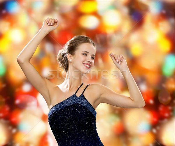 Sorrindo dança as mãos levantadas pessoas festa férias Foto stock © dolgachov