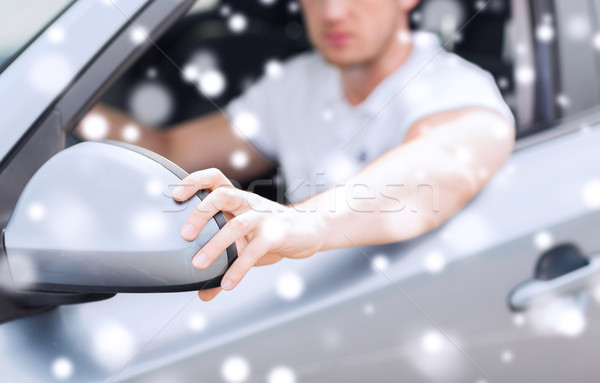 close up of man adjusting car sideview mirror Stock photo © dolgachov