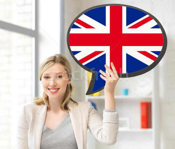 Mosolygó nő szöveg buborék brit zászló oktatás nyelv Stock fotó © dolgachov