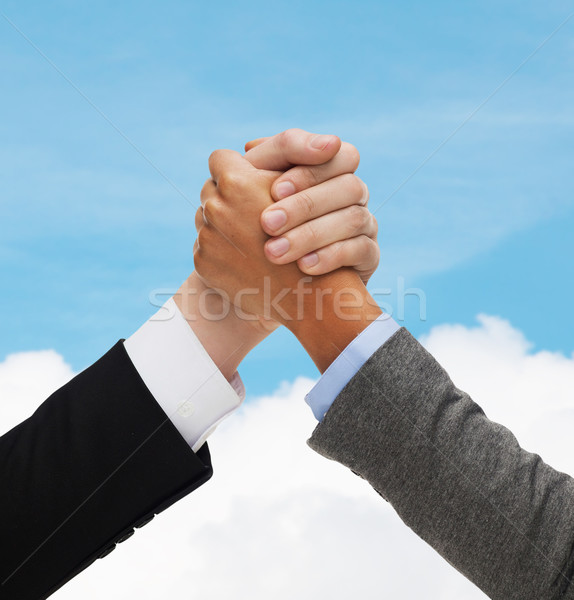 close up of hands armwrestling over concrete wall Stock photo © dolgachov