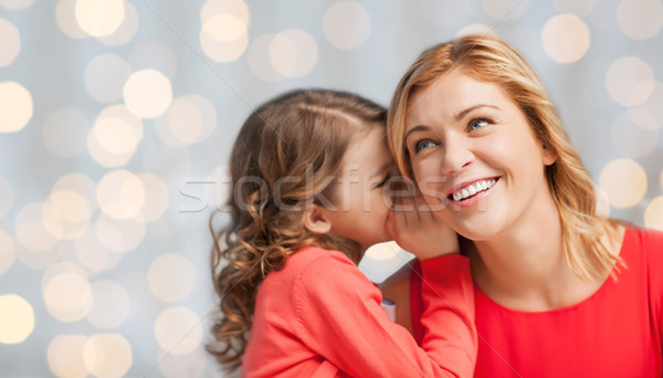 Stock photo: happy daughter whispering gossip to her mother