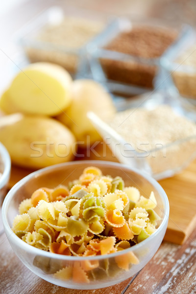 close up of pasta in glass bowls on table Stock photo © dolgachov