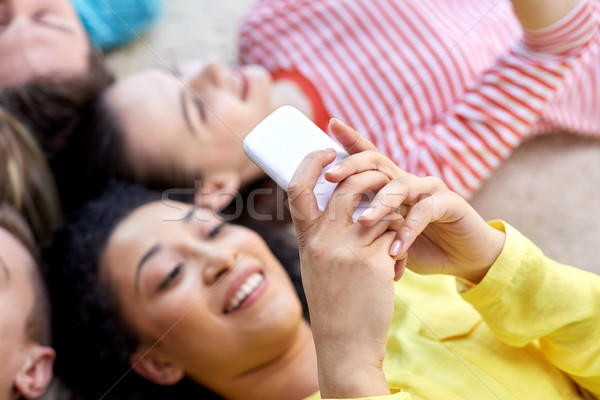 Stock photo: close up of students or friends with smartphones