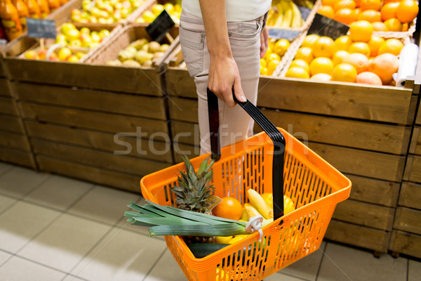 close up of woman with food basket in market Stock photo © dolgachov