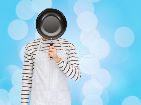 Férfi szakács kötény rejtőzködik arc mögött Stock fotó © dolgachov
