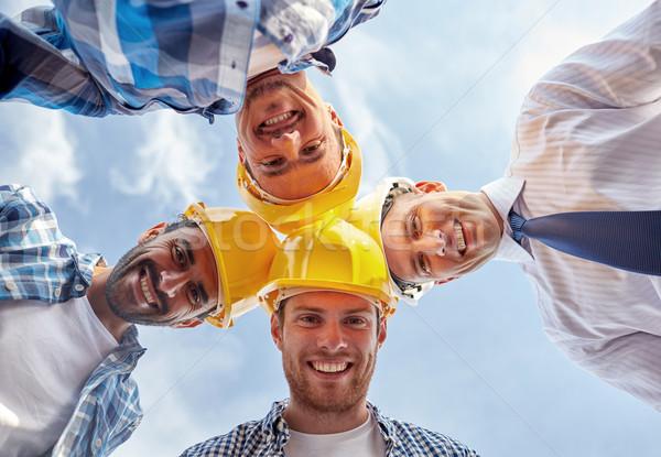 Közelkép építők visel kör üzlet épület Stock fotó © dolgachov