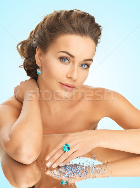 woman with cocktail ring and stones Stock photo © dolgachov