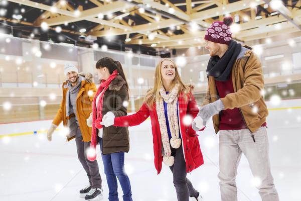 Boldog barátok korcsolyázás pálya emberek barátság Stock fotó © dolgachov