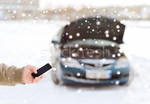 closeup of man with broken car and smartphone Stock photo © dolgachov