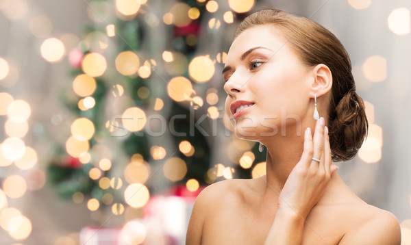 beautiful woman with diamond earrings and bracelet Stock photo © dolgachov