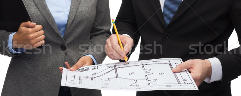 businesspeople with clipboard, blueprint, helmet Stock photo © dolgachov
