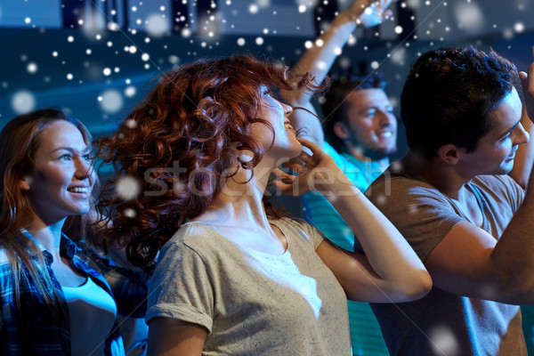 happy friends dancing at night club Stock photo © dolgachov