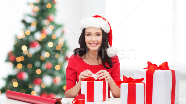 woman in santa helper hat with many gift boxes Stock photo © dolgachov