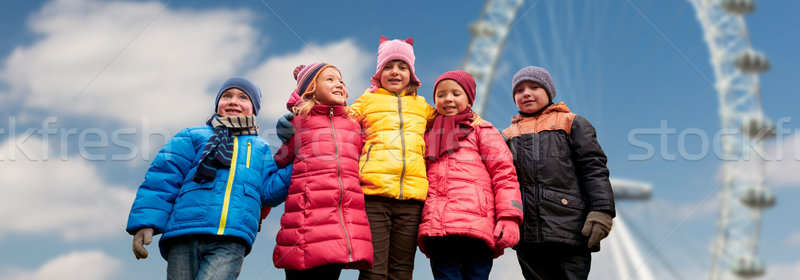 Feliz pequeno crianças faces balsa roda Foto stock © dolgachov