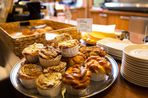 close up of buns and cakes at cafe or bakery Stock photo © dolgachov