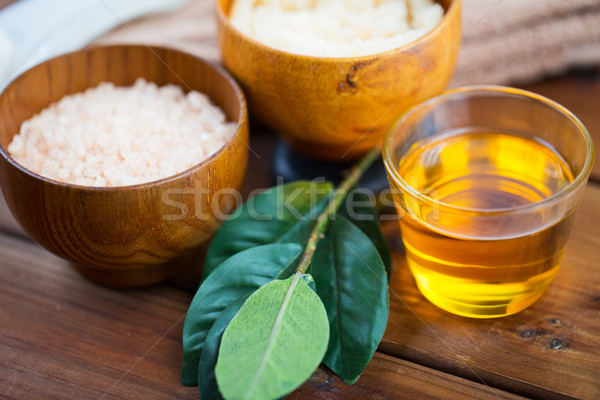 close up of honey in glass with pink salt on wood Stock photo © dolgachov
