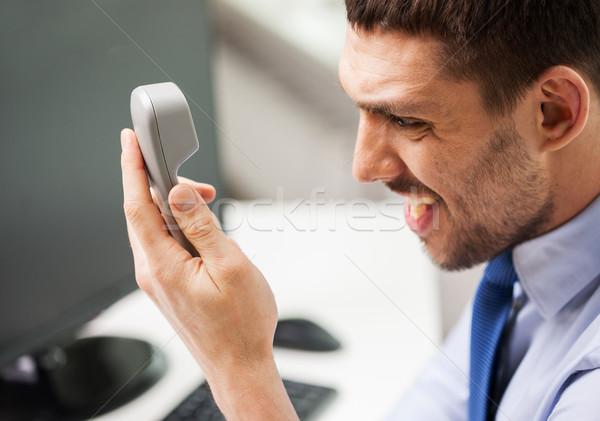 Enojado empresario llamando teléfono oficina gente de negocios Foto stock © dolgachov